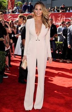Trending Fashion Style: Jumpsuit. - Chrissy Teigen in Elisabetta Franchi long sleeves, plunging v neckline, extra long cream jumpsuit at ESPY Awards 2014.