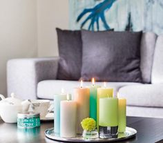 Love the placement of the candles in the center of the coffee table. These colors are fab.