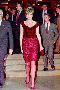 Now here's an outfit literally no one but Princess Diana could pull off. She arrived at the Lille Congress Hall in November 1992 in a royal red 'fit, for the opening of Paul McCartney's oratorio 'Liverpool.'