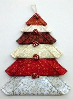 Fabric blocks in different sizes to make a tree decoration. Would be lovely in green or other Christmas colours.