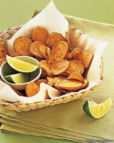 "Baked Sweet-Potato Chips Transform vitamin-packed sweet potatoes into a low-fat ""can't-eat-just-one"" snack simply by tossing with a drizzle of olive oil and baking until crisp-edged. See the ""Baked Sweet-Potato Chips"" in our Sweet Potato Recipes gallery Healthy Snacks, Healthy Eating, Healthy Recipes, Healthy Chips, Easy Recipes, Easy Meals, Clean Eating, Snack Recipes, Cooking Recipes"