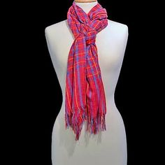 You'll have fun finding new ways to tie this scarf - it's long enough to use in a multitude of ways!  The hottest shade of pink is the primary color - accented with a checkered pattern in multicolors.