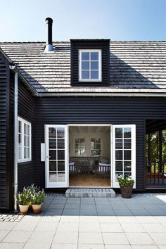 Can't get enough of matte black home exteriors with bright white contrasting trim.