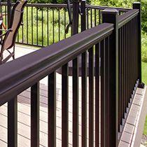 Close up of the deck railing posts - Available at Menards Deck Railings, Hand Railing, Platform Deck, Outdoor Spaces, Outdoor Decor, Diy Deck, Building A Deck, Deck Design, Step Guide