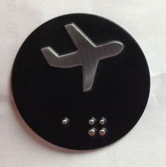 Custom etched CR125 with raised airplane logo and embossed Braille.  www.truxes.com