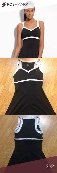 Womens Medium Nike black Border Tennis Dress This is a very lightly worn size medium Nike tennis dress.   There aren't built in shorts but there is a built in sports bra.   Lightweight breathable material and a mesh back, super comfortable.   Bought for $70, only worn a handful of times.  Thanks for looking and feel free to ask any questions! Nike Dresses