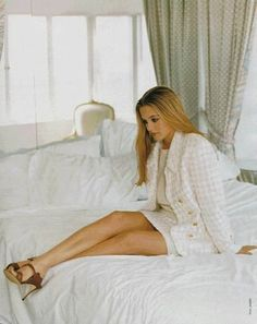 Alicia Silverstone (not sure what she's wearing but I like the contrast of buttoned up demure and sexy)