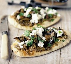 Pizza delivery last night! One of the pizzas was aubergine (eggplant), mushrooms and chunks of mozzarella cheese. I'm going to try to make it at home next time, with this recipe as a base...we always have loads of pitta bread around // Fast feta & aubergine pizzas