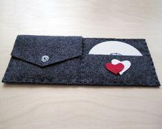 Create a keepsake case out of felt. | 16 Cool Ideas For Homemade Mix CD Artwork