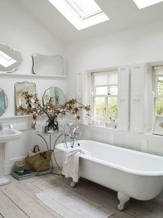 deep and long, claw foot tub - sun lights, big windows.  Love this bathroom