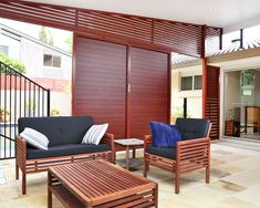 Brisbane) - DecoWood powder coat wood grain finish on extruded aluminium louvres by Vanguard blinds Outdoor Rooms, Outdoor Sofa, Outdoor Furniture, Outdoor Decor, Extruded Aluminum, Pool Landscaping, Shutters, Blinds, Cathedral