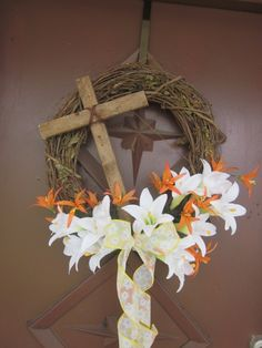 Easter wreath made from idea on pinterest. Salvaged wood cross and lilies.