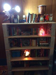 Home made bookshelf using cinder blocks and wood planks.