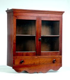 AMERICAN HANGING CABINET. Mid 19th Century. Dovetailed Cherry Cabinet With  Single Dovetailed Door Below
