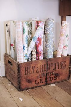 wooden crate storage for rolls of wallpaper or gift wrap... already have some old wooden crates. Could def do this. Looks very cute.