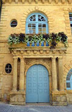Beautiful blue doors and balcony in the village of Sarlat, France.