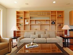 The custom bookcase not only solved the problem of the built-in AC unit, but the shelves provide storage and display in the living area. The large coffee table is distressed and rugged, the perfect place for kicking up your feet and relaxing.
