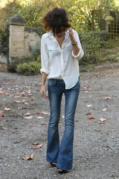 white shirt. casual look and jeans.