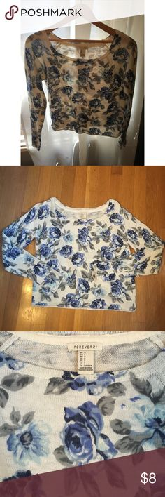 Blue Flowered Crop Top Sweater This Forever 21 Crop Top sweater is in great condition! It has blue flowers with gray. Forever 21 Sweaters Crew & Scoop Necks