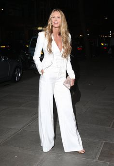 Elle Macpherson is a vision in white. A wide-legged pant keeps the look effortless cool. Shop and be inspired here: http://rstyle.me/~2HpAY