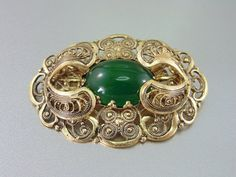 Old Vintage Czech Filigree Brooch with Green glass Cabochon on Etsy, $25.00
