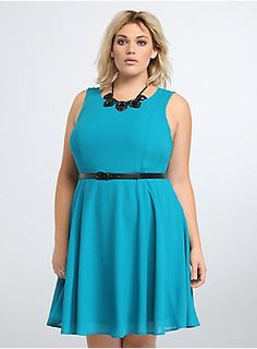 """<p>Go ahead, do a twirl! This flit and float skater dress pretty much demands it. Flouncy teal chiffon covers the A-line style, while multiple seams along the spinning skirt create a figure flattering illusion. A black faux leather belt cinches the style.</p>  <p></p>  <p><b>Model is 5'9"""", size 1</b></p>  <ul> <li>Size 14 measures 40 3/4"""" from shoulder</li> <li>Polyester</li> <li>Wash cold, line dry</li> <li>Imported plus size dress</li> </ul>"""
