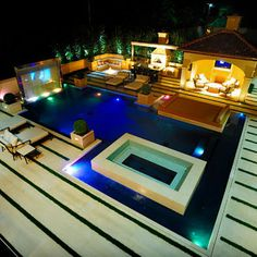 modern pool with movie screen, house, and spa Would love same concept but Mediterranean style.  ...