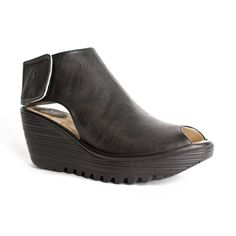 """Pebbled leather on Fly London's infamous wedge. Incredibly comfortable with a modern flair. - 2 1/2"""" wedge with 1"""" platform - Leather upper and lining with synthetic sole - Velcro ankle strap - Padded"""