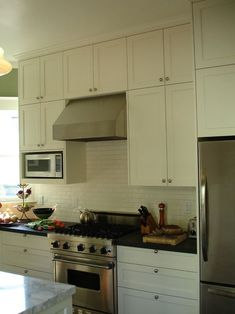 "cabinets are 15"" deep in small kitchen adding needed depth and accomodating Ge Space Saver microwave"