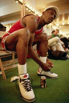 35726fe82995cd MJ lacing up. Michael Jordan
