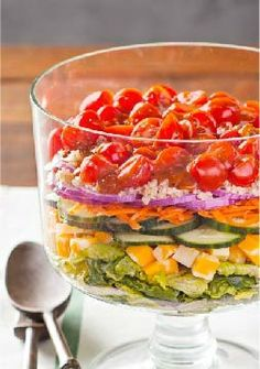 Layered Quinoa Salad — Quinoa adds its own brand of nutty deliciousness in this festive layered salad recipe, made with romaine lettuce, cheese, and grape tomatoes. Bonus: It's ready for the dinner table in just 20 minutes.