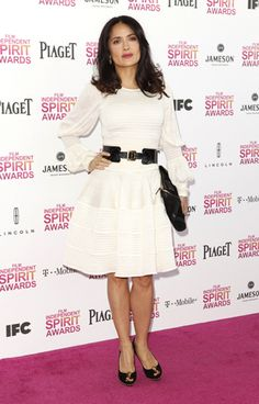 When we start to struggle with our figure & style it's best to discover a body type muse for some style inspiration. I pick Salma Hyak as the muse for my reader who wants to know how to dress a petite hourglass figure.