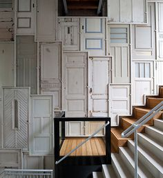Fabulous ways to repurpose old doors, doors, home decor, upcycling, Tomas Mayer presents his version of Alice in Wonderland home d cor with the wall covered in doors #upcycle #creative #reuse