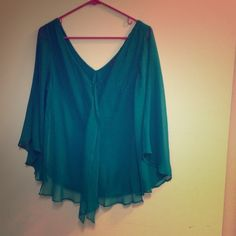 Matty M Teal Silk Chiffon Top Teal top by Matty M. Floaty silk chiffon layer over rayon lining. Neckline is a v in both front and back. Sleeves are sheer (silk only on sleeves - no rayon lining). Matty M Tops