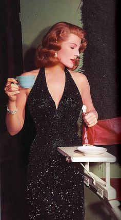Rita Hayworth looking beautiful drinking from a Jadeite Jane Ray cup