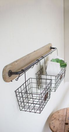 Hang tight. This handy wall addition is about to solve your current organizational conundrum. With two sizable wire baskets, this Anderson Wall Bracket will hold anything from spare toilet paper rolls ...  Find the Anderson Wall Bracket, as seen in the Vintage Industrial Bath Collection at http://dotandbo.com/collections/vintage-industrial-bath?utm_source=pinterest&utm_medium=organic&db_sku=114544