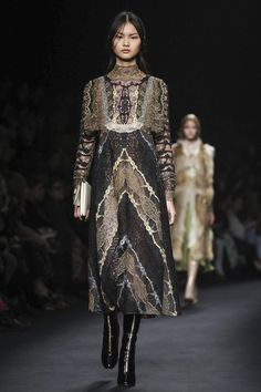 Valentino Ready To Wear Fall Winter 2015 Paris. Mossy, rich fabrics resemble tree bark, a forest floor, and crumpled leaves, ready for autumn. I love how all of those ideas were incorporated into a feminine frock, runway ready.