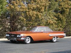 I learned to drive in one of these cars... Love the fins ~ 1960 CHEVROLET IMPALA 2 DOOR HARDTOP