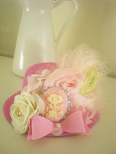 baby top hat,mini hat,top hat,Pink Mini Top Hat,pink mini top hat with pink and cream flowers,mini top hat,special occasion.