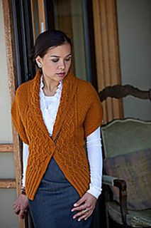 """Pattern Description from Interweave Knits, Fall 2009: """"Okmin Park's ingenious Every Way Wrap turns a simple rectangle, an intricate reversible cable, and two well-placed buttons into a wrap, a shrug, a vest, and a shawl collared cardigan. Through the use of cleverly planned and crossed background stitches between deeply textured cable strands, the texture of one side of the fabric perfectly mirrors the texture of the other."""""""