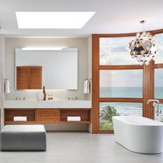 Collection: Litze • Finish: Polished Chrome with Teak Wood • Product: Widespread Lavatory Faucets and Single-Handle Freestanding Tub Filler • Space designed by: Tom Vriesman