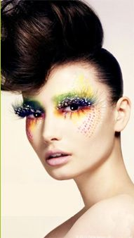 Avant Garde Makeup paired with classic high bun.