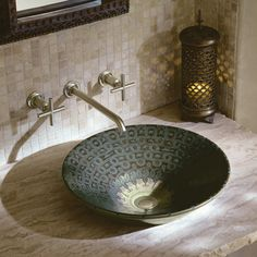 Inspired by a Chinese bronze basin, the Serpentine Bronze™ design on Conical Bell® Vessel Sink is a unique addition to bath and powder rooms.