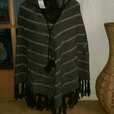$45-BCBGMaxazria hooded poncho BCGB style # BC32194 black/grey/gold size L/XL. Nwt hooded ,sweater poncho with pompom ties. Super cute. But it before I change my mind. All prices open to respectable negotiation & I mail on Sunday BCBGMaxAzria Sweaters Shrugs & Ponchos
