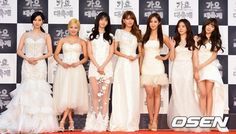 SNSD during the 2014 KBS Music Festival. And their dresses are wedding-worthy.