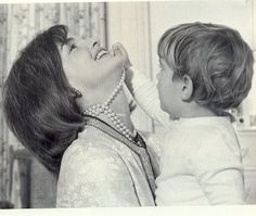 One of my FAVES!  Jackie Kennedy & little JFK Jr. Her 3 strand pearls are now a signature piece for every wardrobe.