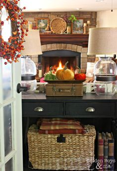 Fall decor in family room with stone fireplace