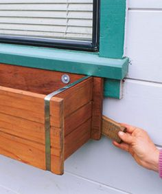 Gaps are good for allowing air circulation behind your window box.