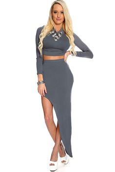Stay classy and fashionable in this sexy 2 pc. outfit! Paired with pumps and accessorize for a complete look, hit the club scene in style. This style features a crop top with a mock neck, long sleeves, matching asymmetrical skirt with an elastic waist, and finished with a tight fit. 85% Polyester 15% spandex.