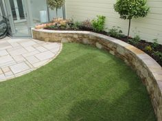 best line for a raised bed in the garden is often a curve.The best line for a raised bed in the garden is often a curve. Small Garden Landscape, Small Garden Design, Landscape Design, Landscaping Retaining Walls, Outdoor Landscaping, Outdoor Gardens, Raised Patio, Raised Garden Beds, Raised Beds